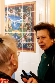 Tiled colourful mural in background, Princess Anne in the foreground